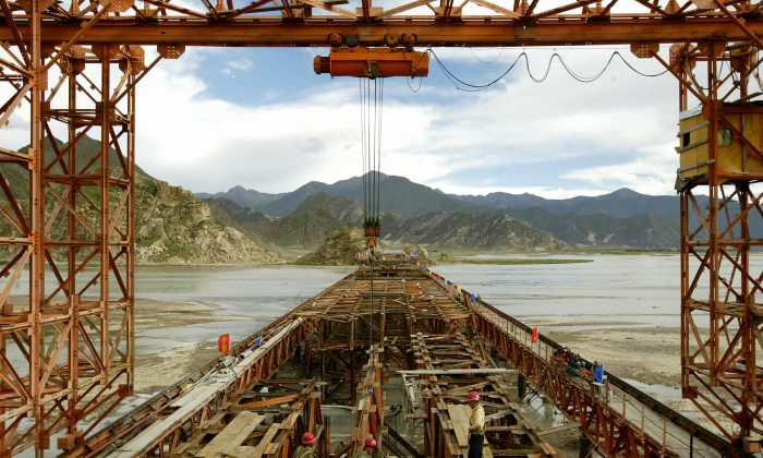 Construction continues on the railway bridge spanning the Lhasa River, part of the 1,532km long Qinghai-Tibet railway outside of Lhasa 14 August 2004. (Peter Parks/AFP/Getty Images)