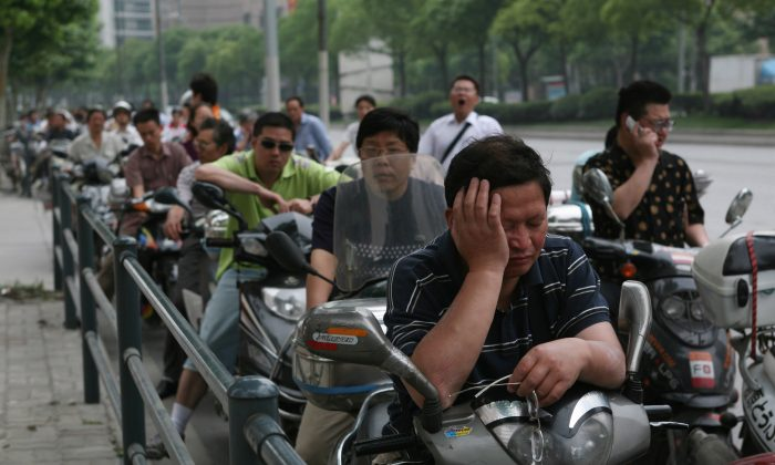 Motorcyclists queue to buy fuel at a petrol station on June 6, 2008 in Shanghai, China. Most gas stations in Shanghai, Beijing and Guangzhou were flooded with cars and motorcycles as rumors went out that fuel price were to be increased. (China Photos/Getty Images)