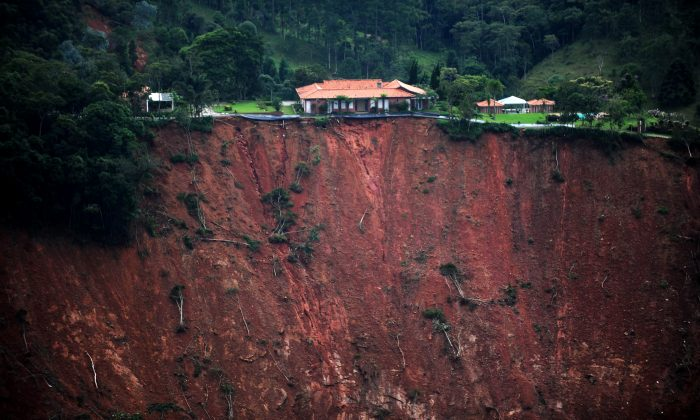Aerial view of a house at risk following landslides in the locality of Poco Fundo, near Petropolis, in the state of Rio de Janeiro, Brazil, on Jan. 18. A week after Taina and Angel Urrutia, and baby Mila, survived the deadliest mudslides in Brazil's history. On Tuesday the country was still counting the dead and struggling to bring aid to survivors. (Vanderlei Almeida/AFP/Getty Images)
