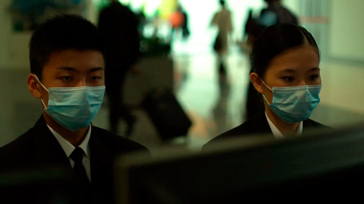 """two Asian people wearing face masks in """"Contagion"""""""