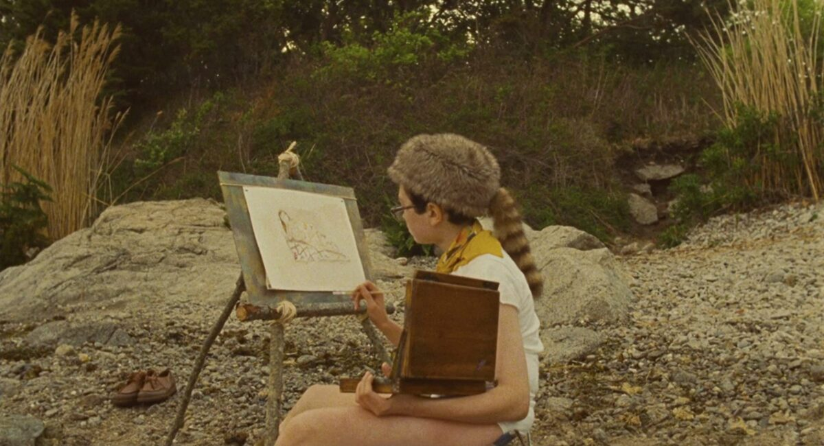 """boy in coonskin cap paints a picture in """"Moonrise Kingdom"""""""