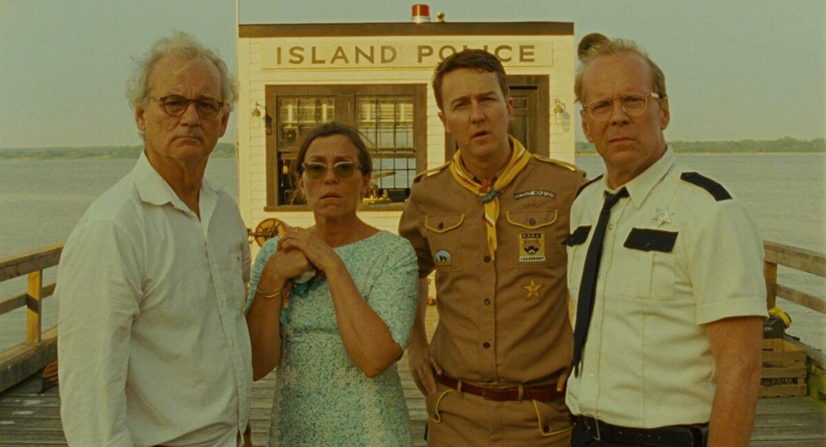 """Three men, one woman in front of police station in """"Moonrise Kingdom"""""""