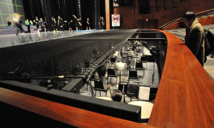 The safety net at the Southern Alberta Jubilee Auditorium covers 2/3 of the orchestra pit. Calgary Shen Yun show organizers say the net and its support beams block the conductor's vision, making vital cues and communication with the performers nearly impossible. (Courtesy Falun Dafa Association of Calgary)