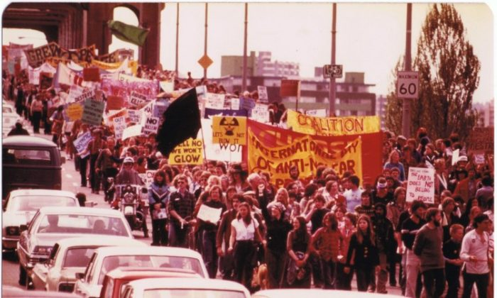 Banners held high, participants flood across the Burrard Bridge during Vancouver's first Walk for Peace in 1982. Vancouver's 30th anniversary Walk for Peace takes place on June 30. (Myriam Dinim)
