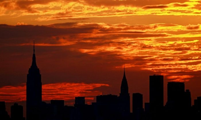 Although the city may never sleep, the sun still sets each night and for optimal health, we should start settling down as the sun is setting as well. (Nick Laham/Getty Images)