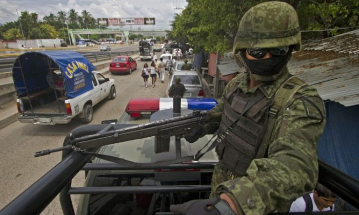 A soldier of the Mexican Army patrols outside a school during a security operation in Acapulco, Mexico, on Sept. 26, 2012. (Pedro Pardo/AFP/Getty Images)