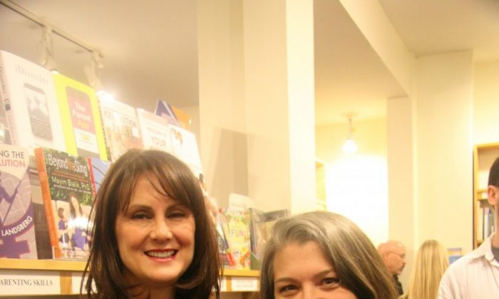 """Lisa Caron (L) and Lisa Doran host a book launch for their second book, """"Joyful Birth: More Childbirth Stories Told by Doulas,"""" at the Parentbooks bookstore in Toronto on Nov. 28, 2012. (Kristina Skorbach/The Epoch Times)"""