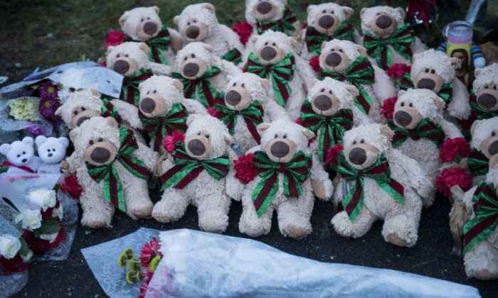Stuffed animals and flowers at a makeshift memorial near the entrance to the grounds of Sandy Hook Elementary School, Dec. 18, 2012, in Newtown, Conn. A gunman killed 20 students and 6 adults four days earlier. (Brendan Smialowski/AFP/Getty Images)