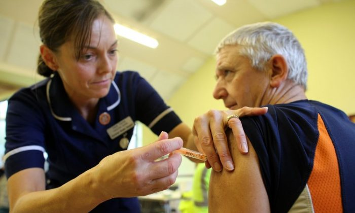 A member of the public is given an inoculation against swine flu at a medical centre in Cockermouth, England on Nov. 25, 2009. A new report warns that the effectiveness of the seasonal flu vaccine has been overstated. (Christopher Furlong/Getty Images)
