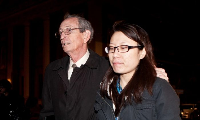"""Jia """"Jenny"""" Hou (R) with her lawyer Martin B. Adelman leaving Manhattan Federal Court in early 2012. Hou, John Liu's campaign treasurer, is facing charges of fraud and obstruction of justice in connection with Liu's 2013 election campaign. (Amal Chen/The Epoch Times)"""