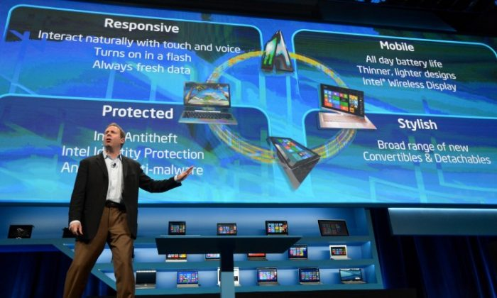 Kirk Skaugen of Intel announces new products at the 2013 CES in Las Vegas. Intel confirmed that it is coming out with a smart TV. (Joe Klamar/AFP/Getty Images)