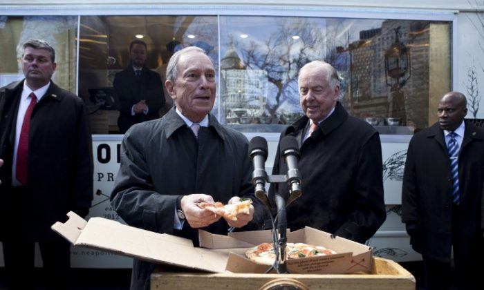 Mayor Michael Bloomberg (2nd from left) introduced the large sugary drink ban, which would have made stores that are given health grades by the city serve drinks that have more than 50 calories in bottles or cups no larger than 16 ounces. Experts say there are other ways to achieve the purpose of the proposed ban, which is temporarily blocked, that is, to help curb obesity. (Samira Bouaou/The Epoch Times)