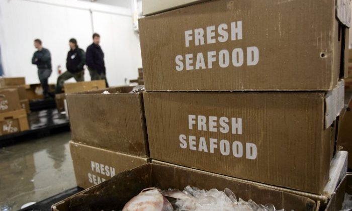 Despite the fact that 85 percent of seafood used in North America is imported from nations with varying standards for aquaculture, the health benefits of fish still outweigh the risks, doctor says. (Spencer Platt/Getty Images)