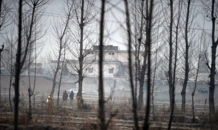Pakistani policemen stand guard beside the compound of slain Al-Qaeda chief Osama bin Laden in northwestern Abbottabad town on Feb. 26, 2012. (Aamir Qureshi/AFP/Getty Images)