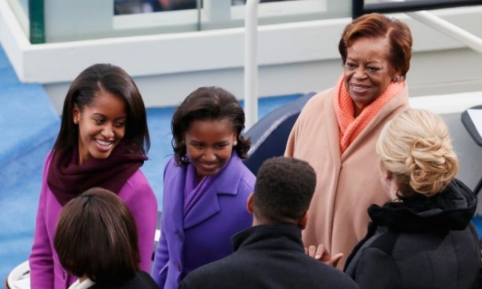Sasha Obama (L) and Malia Obama (C) and mother-in-law Marian Robinson look on following the president's public ceremonial inauguration on the West Front of the U.S. Capitol Jan. 21, 2013 in Washington, DC. (Rob Carr/Getty Images)