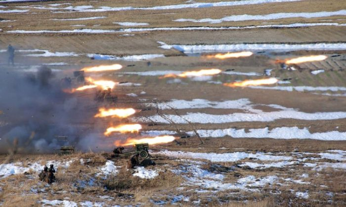 This picture released by North Korea's official Korean Central News Agency on March 26, 2013 and taken on March 25, 2013 shows North Korean female artilleries firing rockets. (KCNA VIA KNS/AFP/Getty Images)