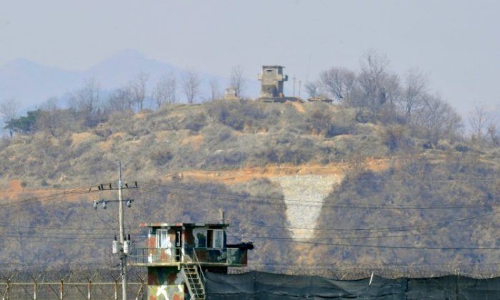 Military guard posts of South Korea (bottom) and North Korea (top) stand opposite each other as seen from in the border city of Paju on March 27, 2013. (JUNG YEON-JE/AFP/Getty Images)