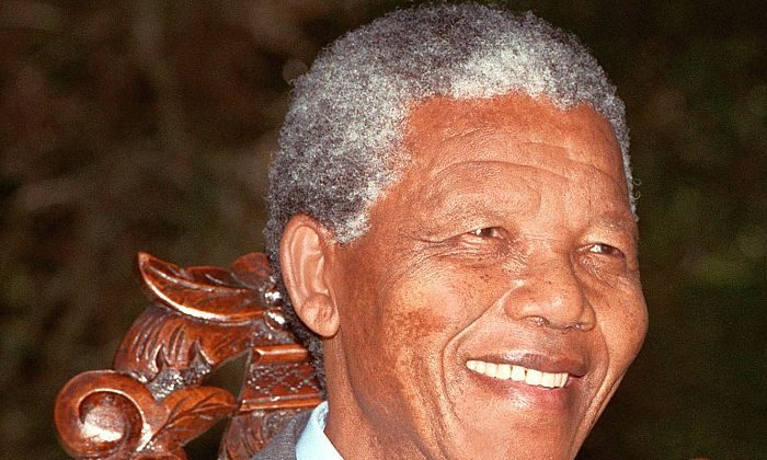 African National Congress President Nelson Mandela shown in a file photo dated Feb. 12, 1990 posing for photographers during a photo session after his first press conference in Cape Town following his release from prison. After his arrest in 1962, a group of activists from London strove to fight apartheid in South Africa. (Walter Dhladhla/AFP/Getty Images)