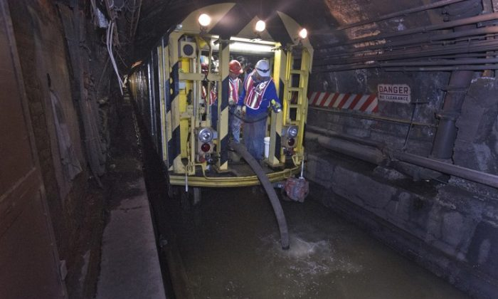MTA employees use a pump train to pump seawater out of the L train tunnel under the East River after Hurricane Sandy. (Metropolitan Transportation Authority / Patrick Cashin)