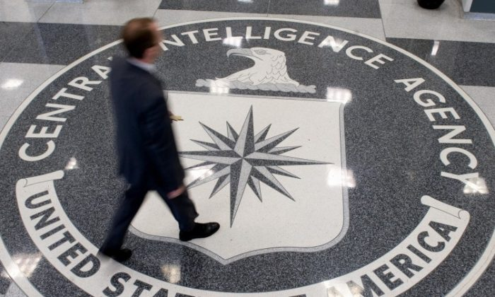 A man walks across the Central Intelligence Agency (CIA) logo in the lobby of CIA Headquarters in Langley, Virginia, in this file photo from 2008. (Saul Loeb/AFP/Getty Images)