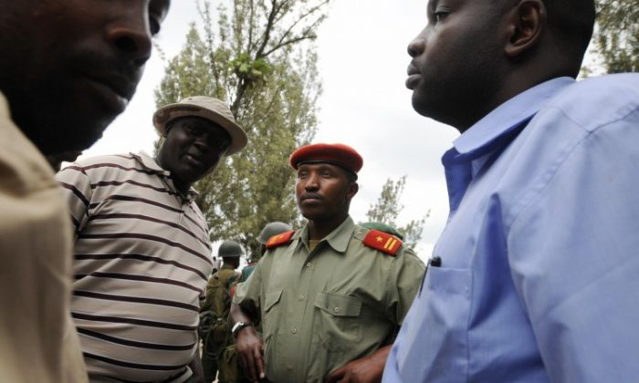 General Bosco Ntaganda (R) stands with fellow officers on January 24, 2009 in Rutshuru, DR Congo, 45 miles (75kms) north of the provincial capital Goma. (Lionel Healing/AFP/Getty Images)
