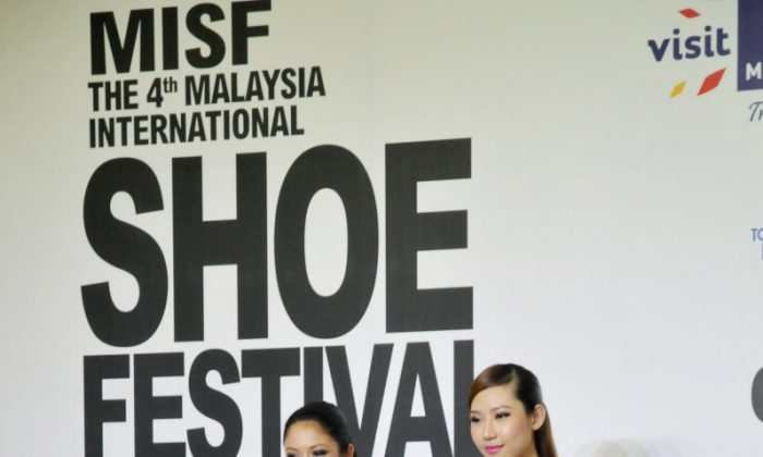 A catwalk showcase of designer shoes during the opening ceremony of MISF The 4th Malaysia International Shoe Festival on March 28, 2013, in Kuala Lumpur, Malaysia. (Sun Mingguo/The Epoch Times)