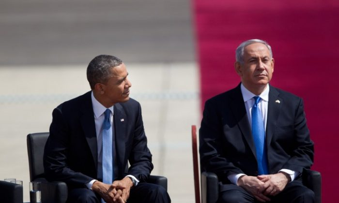 U.S. President Barack Obama (L) sits with Israeli Prime Minister Benjamin Netanyahu (R) during an official welcoming ceremony on his arrival at Ben Gurion International Airport on March, 20, 2013, near Tel Aviv, Israel. (Uriel Sinai/Getty Images)