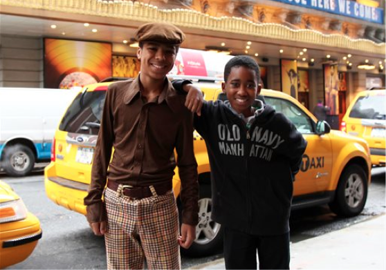 "Actors Jibreel Mawry, left, and Raymond Luke Jr. pose outside the Lunt-Fontanne Theatre in New York, where their show ""Motown: The Musical,"" is playing. The two 12-year-olds are alternating taking on the roles of young Michael Jackson, young Stevie Wonder and a young Berry Gordy. (AP Photo/Mark Kennedy)"