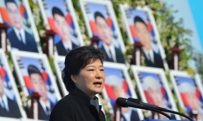 South Korean President Park Geun-Hye speech during the third anniversary of the sinking of a South Korean naval vessel, by what Seoul insists was a North Korean submarine, at the national cemetery in the central city of Daejeon on March 25, 2013 where the 46 sailors who died when the Cheonan corvette sunk are buried. (Kim Jae-Hwan/AFP / Pool)
