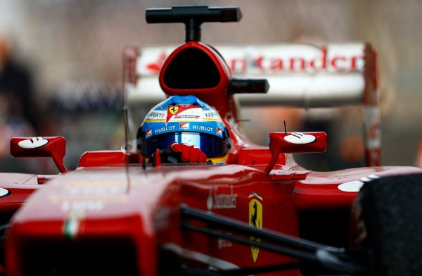Fernando Alonso drives into parc ferme after winning the Chinese Formula One Grand Prix at the Shanghai International Circuit on April 14, 2013 in Shanghai, China. (Vladimir Rys/Getty Images)