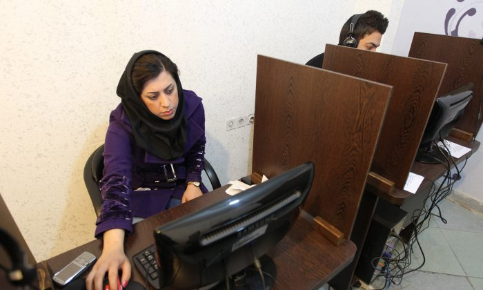 Iranians surf the Internet at a café in Tehran on Jan. 24, 2011, a day after Iran officially launched its cyberpolice unit. Iran has dedicated great effort to increasing its cyberwarfare capabilities. (Atta Kenare/AFP/Getty Images)