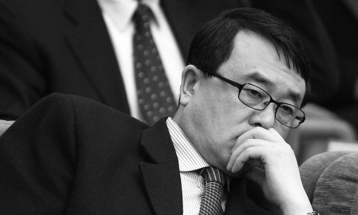 Wang Lijun, former chief of the Chongqing public security bureau, attends a political meeting in March 2011. By February of this year his political fate was sealed. His little-known involvement in organ harvesting and political persecutions in China is now being publicized. (Feng Li/Getty Images)