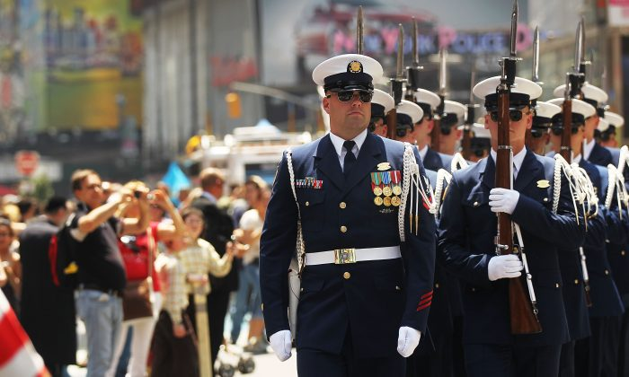 The U.S. Coast Guard Ceremonial Honor Guard's Silent Drill Team walks through Times Square after putting on a performance as part of Fleet Week festivities May 27, 2011 in New York City. (Spencer Platt/Getty Images)