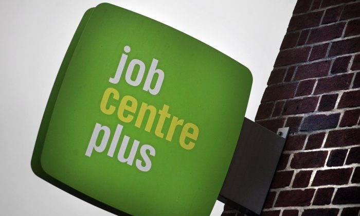 The Job Centre Plus logo is seen displayed outside the employment office in Trowbridge, England.  (Matt Cardy/Getty Images)