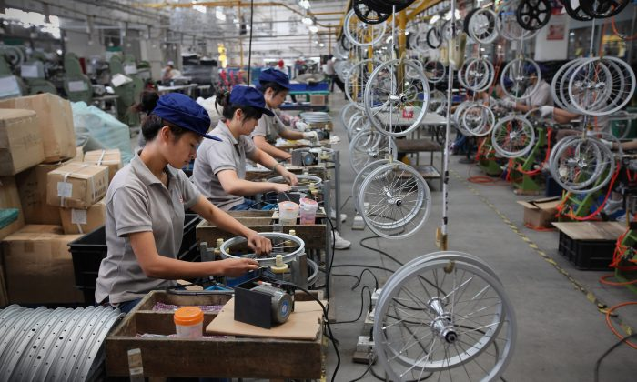 An undated photo shows workers assembling children's bicycle wheels at a factory in China. (Feng Li/Getty Images)