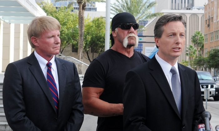 TV personality Terry Bollea aka Hulk Hogan(C) and his attorneys David Houston (L) and Charles Harder (R) attend for a press conference to discuss legal action being brought on his behalf October 15, 2012 in Tampa, Florida. One of the civil lawsuits was against Gawker Media. (Gerardo Mora/Getty Images)