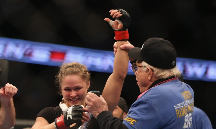 Ronda Rousey celebrates her UFC Bantamweight Title over Liz Carmouche on February 23, 2013 in Anaheim, California. (Jeff Gross/Getty Images)