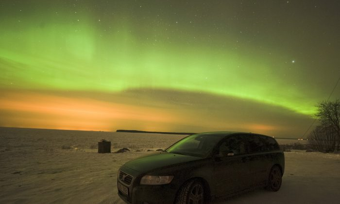 The Aurora Borealis can be seen over Northern Europe on Tuesday night because of a solar storm hitting the Earth. People in Scotland, Ireland, Norway, Finland, and Sweden said they could see the Northern Lights.  (RAIGO PAJULA/AFP/Getty Images)