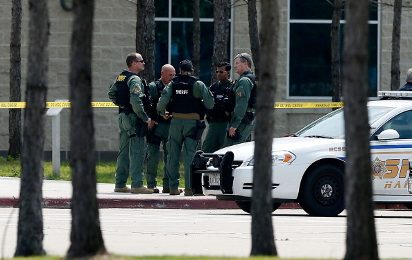 Texas college stabbing: Harris County Sheriff officers seal off the campus after at least 14 people were injured in a stabbing incident at the Cy-Fair campus of Lone Star College on April 9, 2013 in Cypress, Texas. (Scott Halleran/Getty Images)