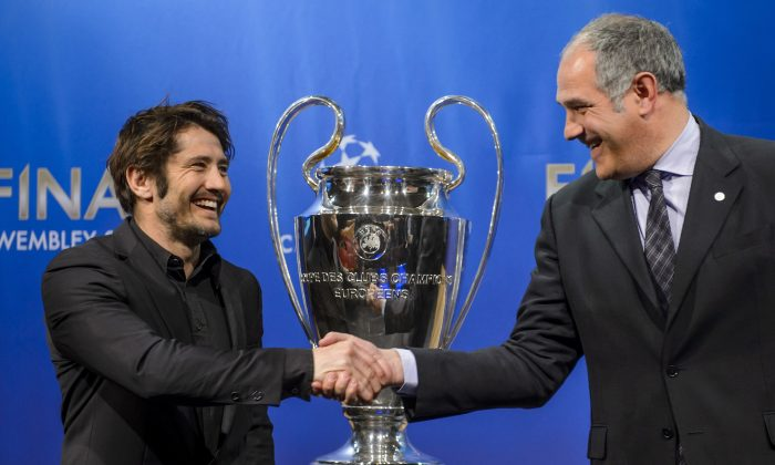 Bayern Munich's Bixente Lizarazu (L) shakes hands with Barcelona's Andoni Zubizarreta after the draw for the semi-finals of the UEFA Champions League on April 12. (FABRICE COFFRINI/AFP/Getty Images)