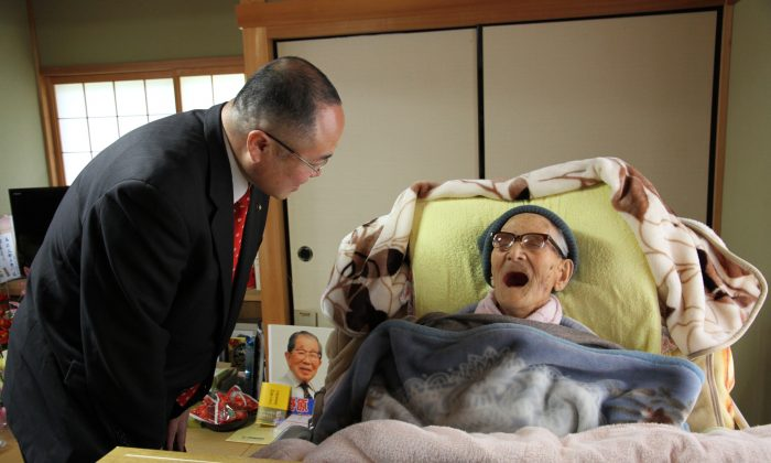 In this handout image provided by Kyotango City government, the world's oldest person Jiroemon Kimura is celebrated by Kyotango City Mayor Yasushi Nakayama as he celebrates his 116th birthday at his home on April 19, 2013 in Kyotango, Kyoto, Japan. (Kyotango City Government via Getty Images)