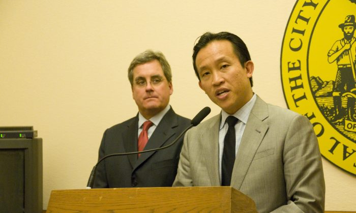 Board of Supervisors President David Chiu speaks while City Attorney Dennis Herrera looks on at San Francisco City Hall, April 23, 2013. (Lear Zhou/The Epoch Times)