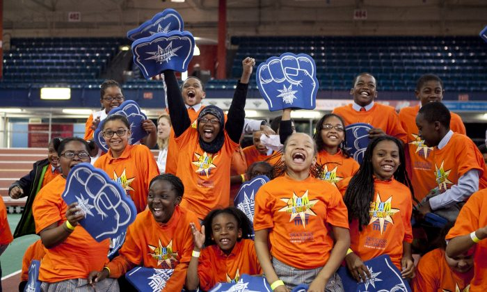 "About 1,500 Success Academy students from 14 public charter schools in the Bronx and Harlem participate in a ""Slam the Exam Pep Rally,"" at the Washington Heights Armory. (Samira Bouaou/The Epoch Times)"