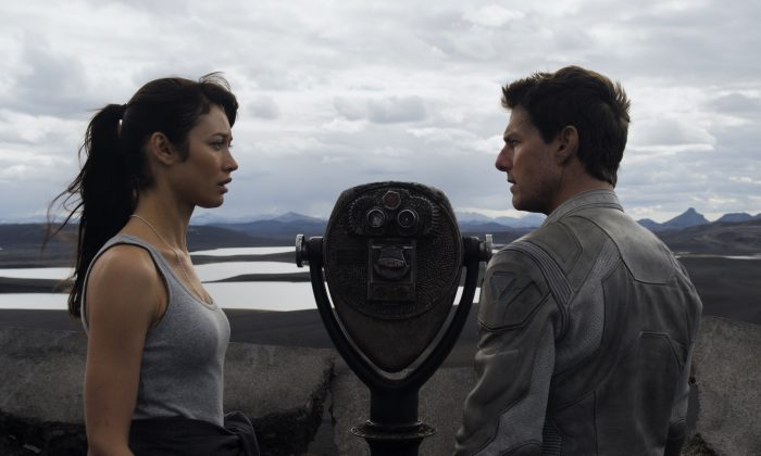 """Julia (Olga Kurylenko) provides Jack (Tom Cruise) clues to his past in """"Oblivion"""", an original and groundbreaking cinematic event from the visionary director of """"TRON: Legacy""""and producers of """"Rise of the Planet of the Apes."""" (Courtesy of Universal Pictures)"""