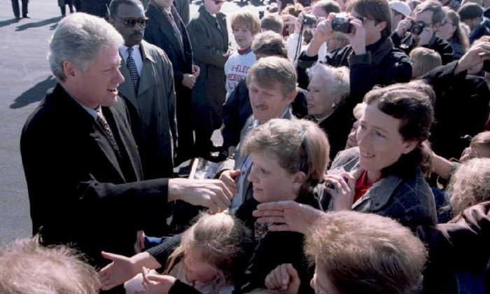 Then-president Bill Clinton (L) greets people in 1995 at the airport in Little Rock, AK. The airport was recently renamed after Bill and Hilary Clinton, who will attend a ceremony marking the first phase of renovations.(Luke Frazza/AFP/Getty Images)