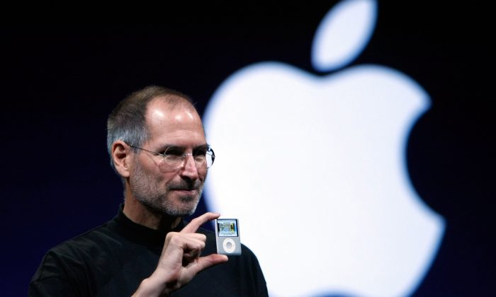 In this file photo, Apple CEO Steve Jobs holds up a new version of the iPod Nano during an Apple event in San Francisco, September 2007. (Justin Sullivan/Getty Images)
