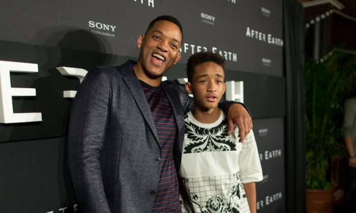 """Actors Will Smith and Jaden Smith attend the """"After Earth"""" party at The 5th Annual Summer Of Sony at the Ritz Carlton Hotel in Cancun, Mexico, on April 23, 2013. (Christopher Polk/Getty Images for Sony Pictures)"""