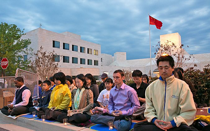 Falun Gong practitioners hold a candle light vigil outside the Chinese Embassy in Washington D.C. on April 24, 2013. (Lisa Fan/The Epoch Times)