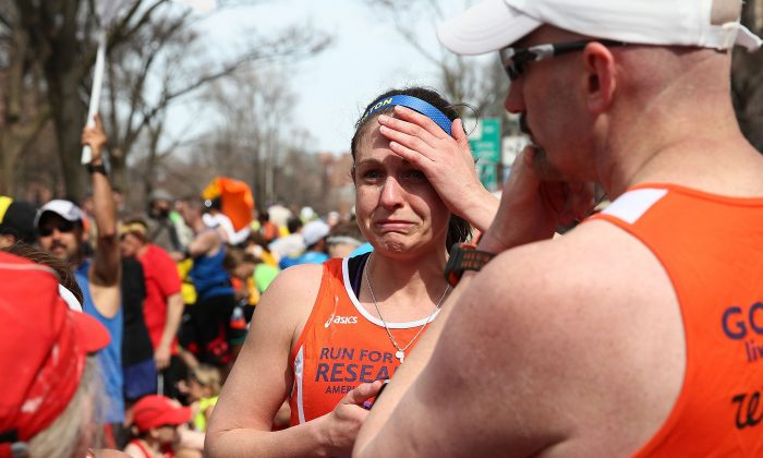 A runner reacts near Kenmore Square after two bombs exploded during the 117th Boston Marathon on April 15, 2013 in Boston, Massachusetts. (Alex Trautwig/Getty Images)