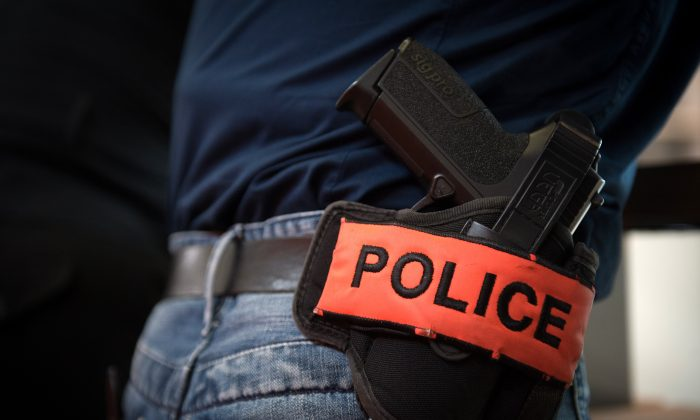 A police firearm is shown in this file photo.  The national debate about gun-control has focused on limiting access to firearms, but safe use and storage of legally owned guns is an ongoing issue. (Martin Bureau/AFP/Getty Images)